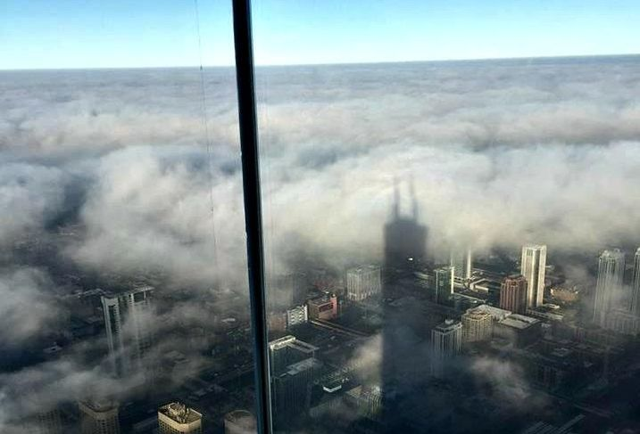 A view of Chicago, obscured by clouds, from Willis Tower's Skydeck.