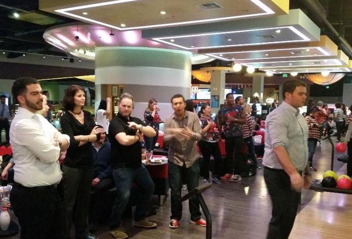 Rosano Partners team members go bowling as a company