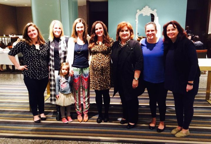 Amy Tharp (center) at her baby shower; COO of Downtown Dallas Inc