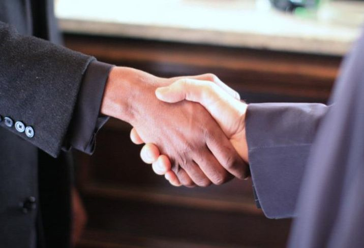 Shaking hands, making a deal, transaction, deal volume