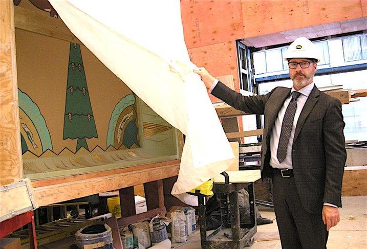 Oxford VP Mark Cote with a historic ceiling panel from the Concourse Building
