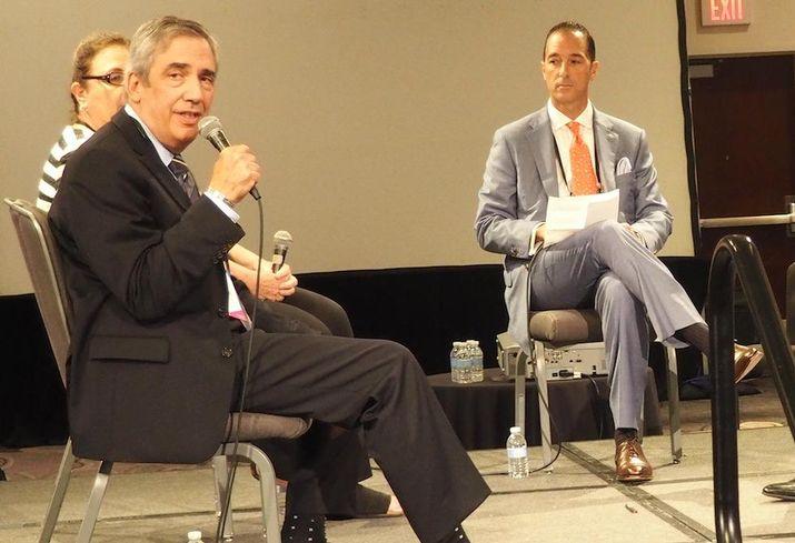 Savills Executive Managing Director Marc Magazine speaking at Bisnow's Lodging Investment Series