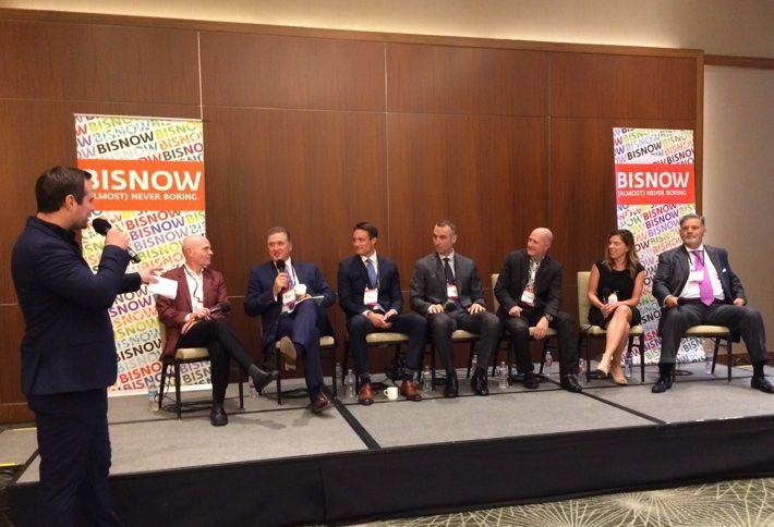 Healthcare panel at Healthcare Leadership & Life Sciences Forum with Bisnow's Kyle Nicholes, left.