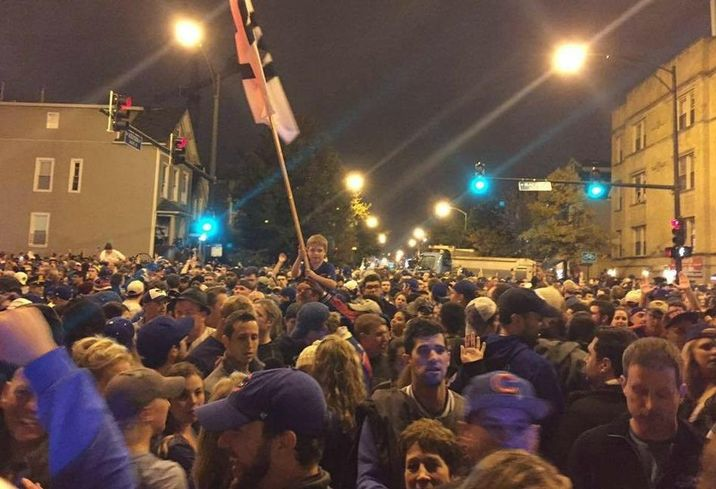 The son of Cushman & Wakefield Americas Head of Marketing Adrienne Fasano celebrates after the Cubs win the World Series.