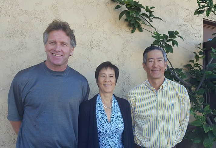 Colliers International SVP Ted Cuthbert with TechBilt Cos principals Jenny Tchang and Ted Tchang, who are sister and brother.