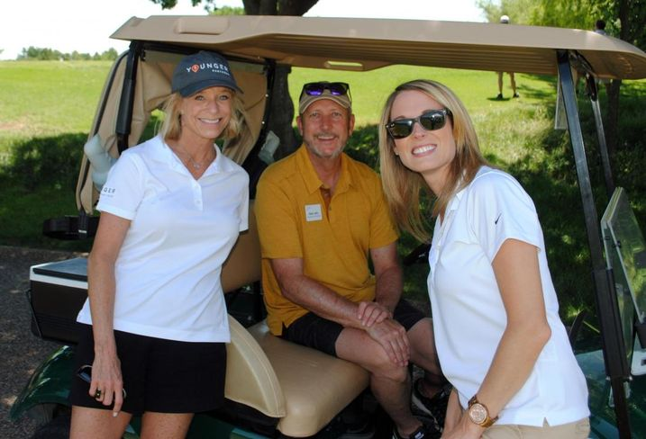 Younger Partners' Kathy Permenter with NTCAR's Brian Jetty and Younger Partners' Lacey Queen at the NTCAR annual golf tournament in June.
