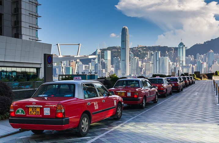 Taxis in front of the International Commerce Centre, Kowloon Waterfront, Hong Kong