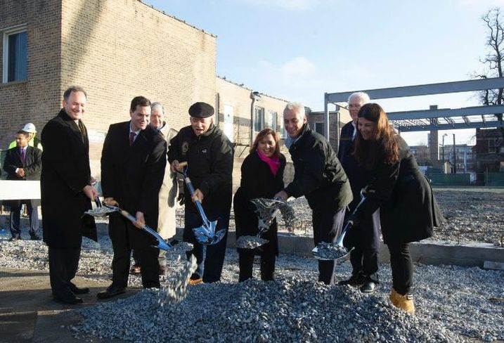 Merit Partners' partner Paul Fishbein, Clark Street Real Estate principal Peter Eisenberg, Illinois state Rep. Luis Arroyo, Ald. Milly Santiago (31st), Chicago Mayor Rahm Emanuel and Chicago Buildings Commissioner Judy Frydland at the Retail at the Fields groundbreaking, Jan.18,2017.