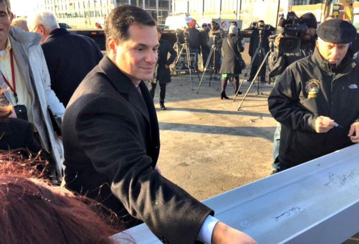 Clark Street Real Estate principal Peter Eisenberg signs the ceremonial beam at the Retail at the Fields groundbreaking in Chicago, Jan. 18, 2017.