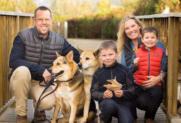 Phillip Voorhees & family: wife, Kristen, and sons, Mercer and Nicholas. The dogs are Rover and Stu.