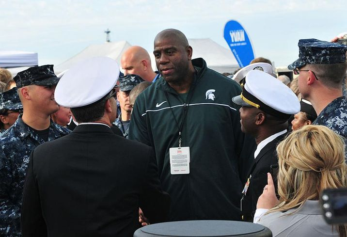 SAN DIEGO (Nov. 11, 2011) Magic Johnson greets service members attending the Quicken Loans Carrier Classic basketball game on the flight deck of the aircraft carrier USS Carl Vinson (CVN 70). Carl Vinson is hosting Michigan State University and the University of North Carolina for an NCAA basketball game. (U.S. Navy photo by Mass Communication Specialist Seaman Apprentice George Bell/Released)