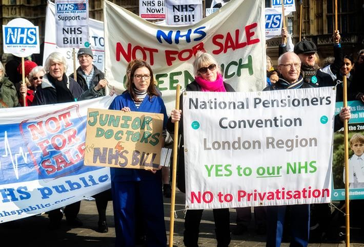 Protestors marching for the NHS