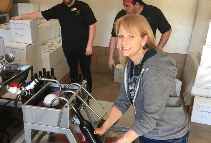 Leslye Corsiglia bottling wine at Martin Ranch Winery