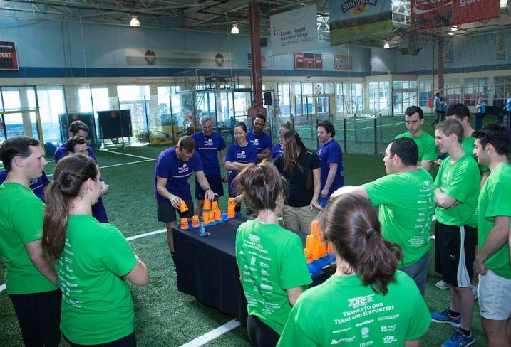 Cup stacking competition at the second annual JDRF Real Estate Games at Chelsea Piers.