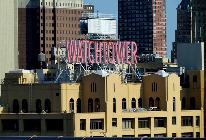 The Watchtower Sign Will Come Down For The Building's Next Life