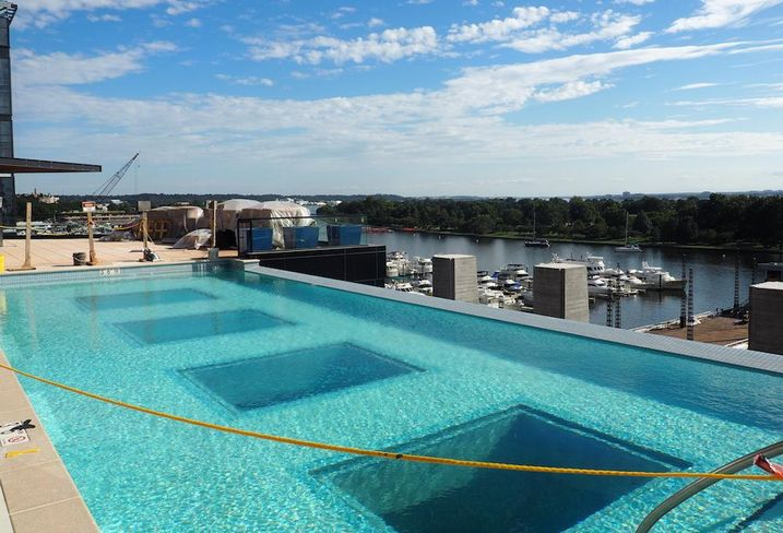 The outdoor pool at The Wharf's Channel apartment building, above The Anthem music venue