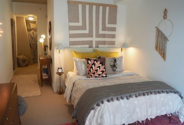 The bedroom in the 1-br model unit at The Channel