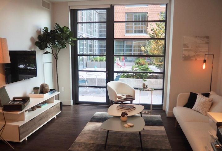 The living room inside the model unit at The Wharf's 148-unit Incanto building