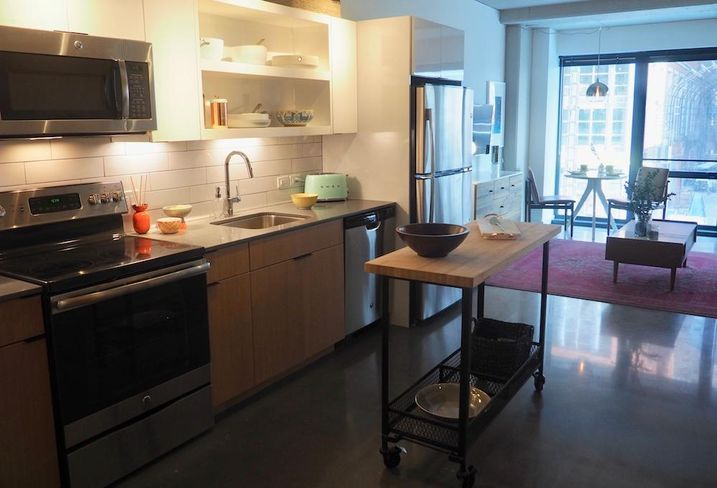 The kitchen and living room in The Channel's one-bedroom model unit