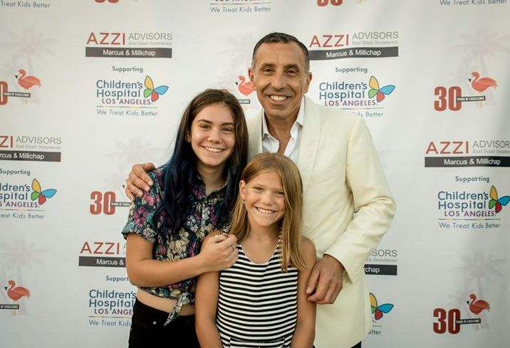 Azzi Advisors President and Executive Managing Director Investments at Marcus & Millichap Tony Azzi and his two daughters, Gianna, left, and Davina, at an event at his home.
