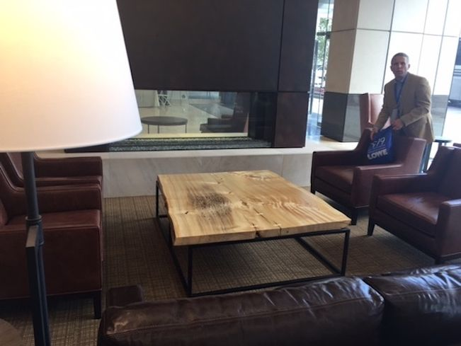 The lobby at Colorado Center Tower 3 has inviting seating areas and a large conference table