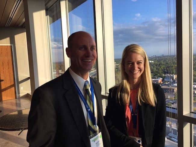 Scott Caldwell of Lincoln Property Co. with Bisnow's Jenna Bruce at Colorado Center Tower 3 during NAIOP Southeast Suburban Denver property tour