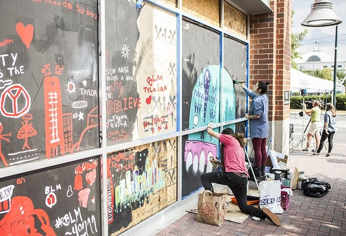 After the Hyatt House windows were smashed in during protests in Uptown in September 2016, management invited artists to paint boarded-up windows. These paintings have since been displayed at Levine Museum of the New South's