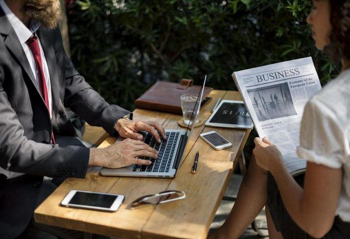 Newspaper, reading the newspaper, millennials, work, career, professionals