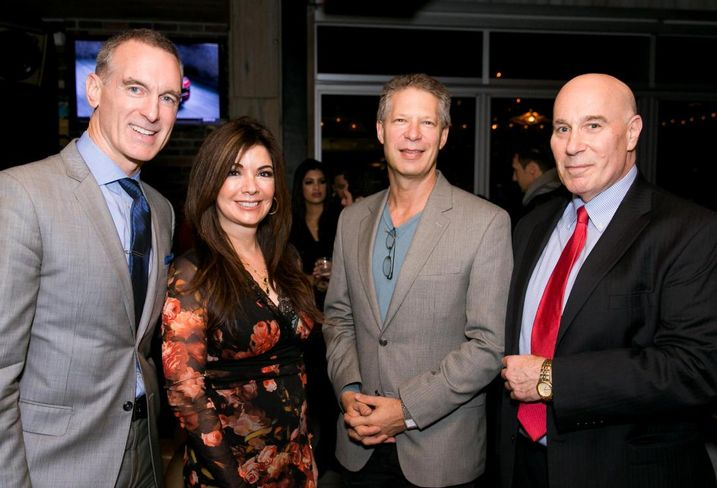 Rand Engineering & Architecture's Peter Scallion, Eastern Consolidated's Adelaide Polsinelli, The Riese Org.'s James Rosenzweig and Rand's Jeffrey Stein at a rooftop client party hosted by Polsinelli