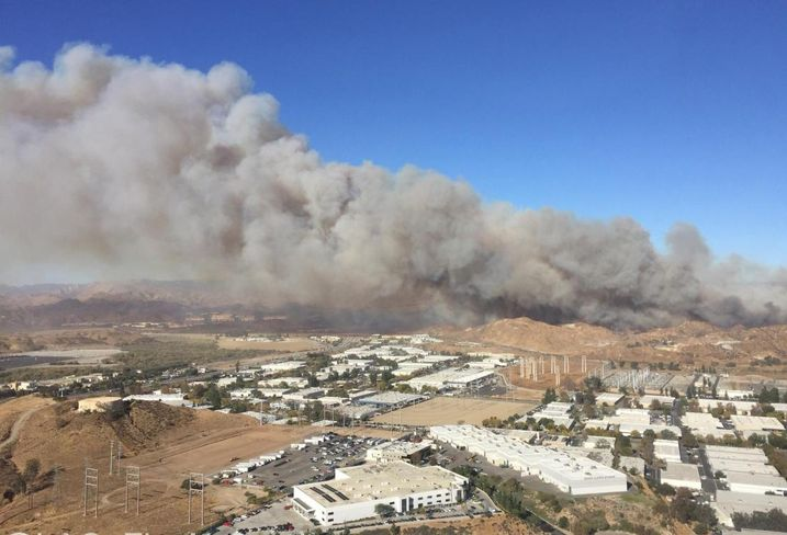 A large plume of smoke from the Creek Fire could be seen above Sylmar as a wildfire continues to burn the area.