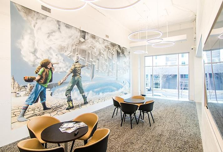 The lobby of 300 South Brevard includes a presentation area with a mural by Matt Hooker, Matt Moore and Tucker Sward.