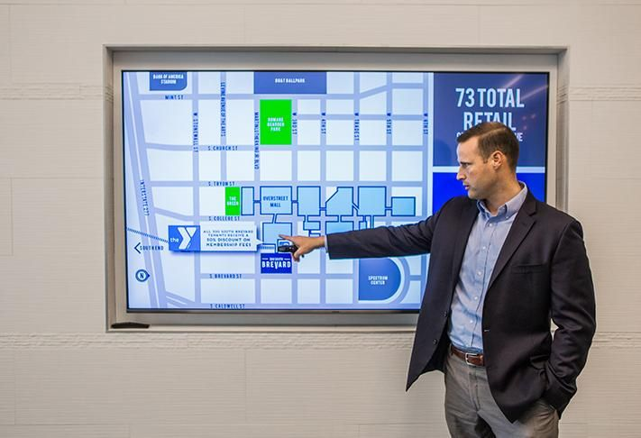 300 South Brevard offers access to LYNX Light Rail's Third Street Station and Overstreet Mall. Stream Realty Partners vice president Jay Coleman shows the office tower's building in proximity to other spaces in Uptown.