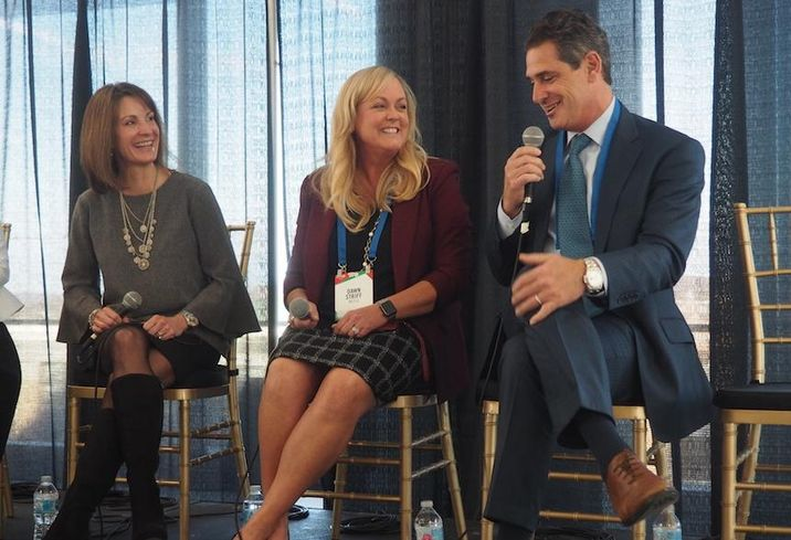 Rosslyn BID's Mary-Claire Burick, Nestle's Dawn Striff and Monday Properties Tim Hemig