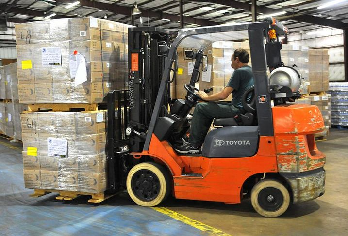 Forklift truck in a warehouse