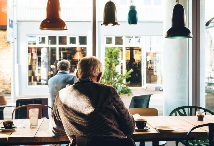 Senior sitting in a coffee shop