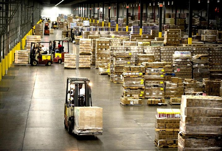 A warehouse with forklifts in use