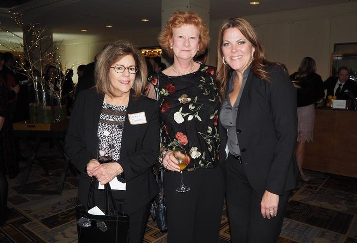Piedmont's Cheryl Dennis, Boston Properties' Caroline Kruger and Capitol Concierge's Misty Tieman at AOBA's holiday party
