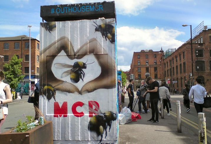 Manchester's bee symbol, street art in Stevenson Square in the Northern Quarter, following the May 2017 terrorist attack in the city