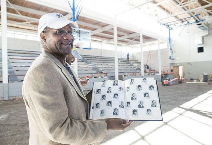 Arthur Griffin grew up a few blocks from Brooklyn Charlotte. After being forced out of downtown due to urban renewal, he would grow up to become the School Board chair and Head of the Black Political Caucus. Here, he shows off his yearbook at the Second Ward High School gym, which is being renovated into a community center and museum.