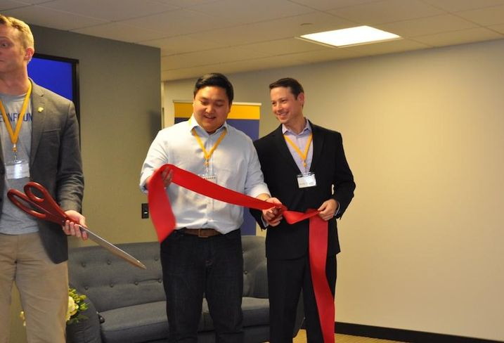 Eastern Foundry CEO Andrew Chang and JLL's Andy O'Brien at the ribbon cutting of the Rosslyn location
