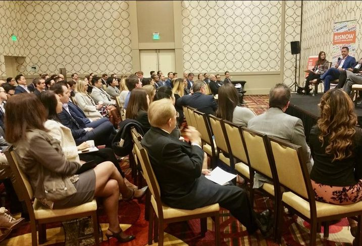 The crowd listens to Pender Capital's Co-Founder's Zach Murphy during Bisnow's Los Angeles Capital Markets and Foreign Investments panel Feb. 28, 2017 at the JW Marriott in Los Angeles. Pircher, Nichols & Meeks' Erin Natter, Pender Capital's Co-Founder's Zach Murphy, JP Morgan Chase Bank's Kenya Williams, Mosaic Real Estate Investors Vicky Schiff, Canyon Partners Real Estate Spencer Schlee and Institutional Property Advisors Anita Paryani Rice.