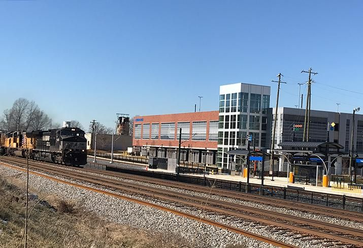 A train approaches on tracks that run parallel to the LYNX Light Rail line at the future Sugar Creek Station.