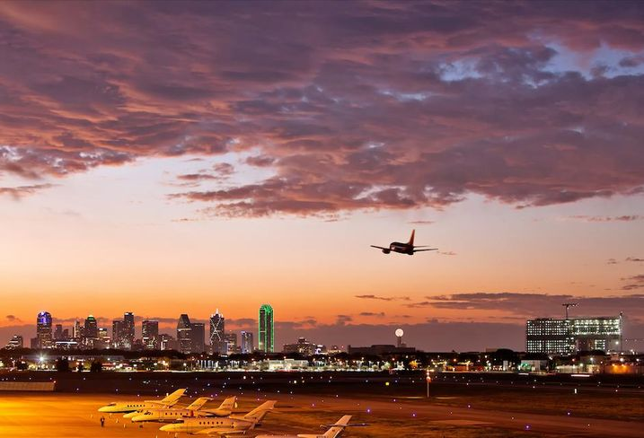 A plane flying over Dallas.