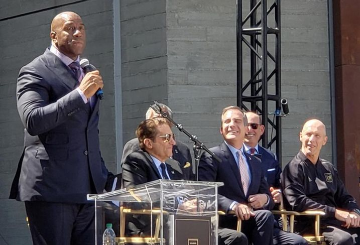 Magic Johnson, co-owner of LAFC, speaks on the mic during a ribbon cutting ceremony April 18, 2018 at the new Banc of California stadium  in the Exposition Park neighborhood of Los Angeles.