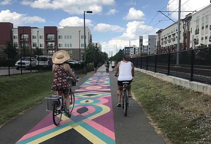 Charlotte's Rail Trail runs along the LYNX Blue Line light rail. Surrounded by multifamily developments, it is popular with cyclists and pedestrians.