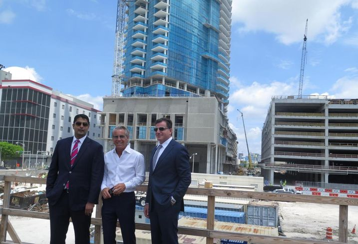 Miami Worldcenter Associates Managing Partner Nitin Motwani, Forbes Co. President Nate Forbes and Royal Palm Cos. founder Dan Kodsi are all partners in Miami Worldcenter. A condo tower, Paramount, is under construction behind them.