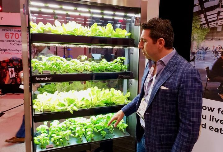 Farmshelf CEO Jean-Paul Kyrillos demonstrates an indoor hydroponics system at the ICSC RECon event in Las Vegas.