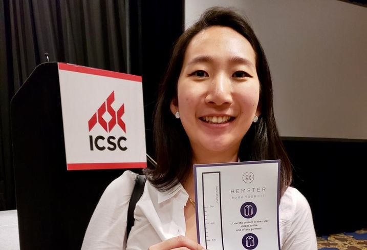 Hemster CEO Allison Lee holds up her patent pending ruler sticker that easily allows sales associates to measure a customer at the ICSC RECon event in Las Vegas.