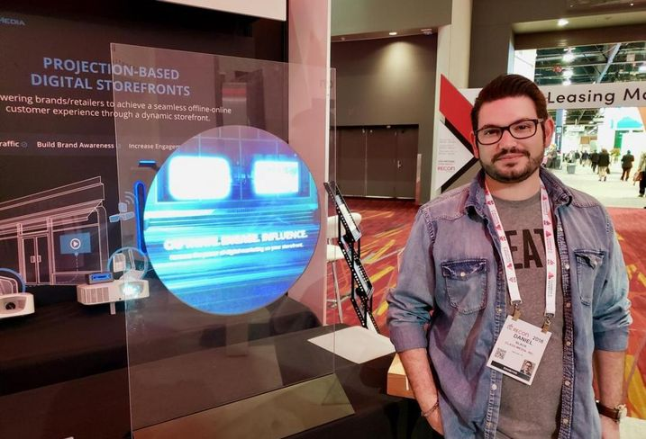 Glass-Media CEO Daniel Black displays his company's projection based digital storefront at the ICSC RECon event in Las Vegas.