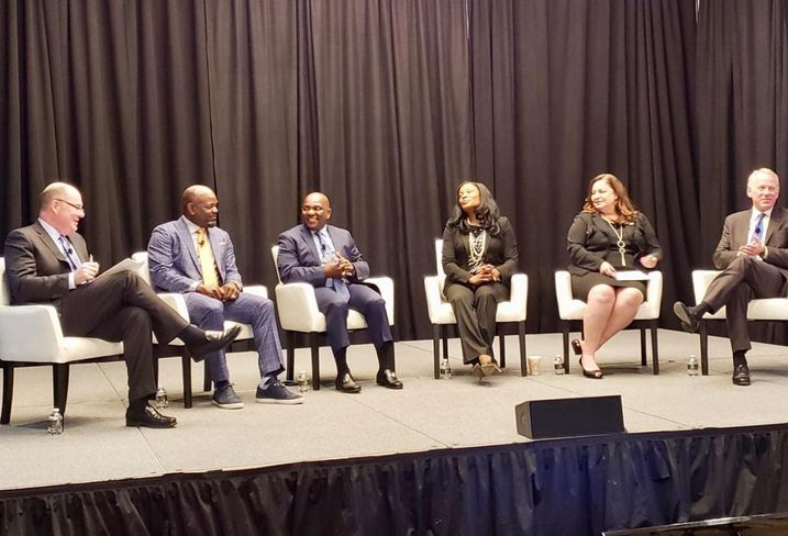 ICSC Tom McGee, former NFL player Emmitt Smith, Chicago TREND's Lyneir Richardson, NFL's Jocelyn Moore, CREW Network's Wendy Mann and JLL's John Gates.